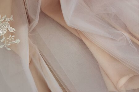 Fabric with Luxurious pattern and large folds, delicate background. Smooth and rich drapes texture. 写真素材