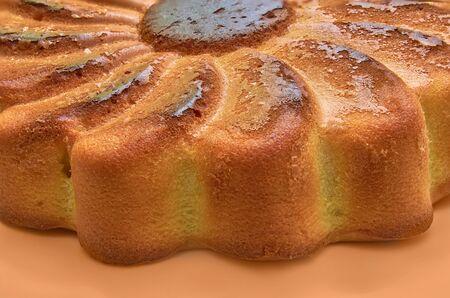 Freshly baked and burnt cake before you flip