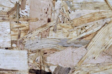 OSB material texture - recycled compressed wood shavings plate, plywood texture. 版權商用圖片