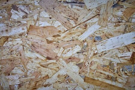 Wood panel made from wood chips texture background. 版權商用圖片