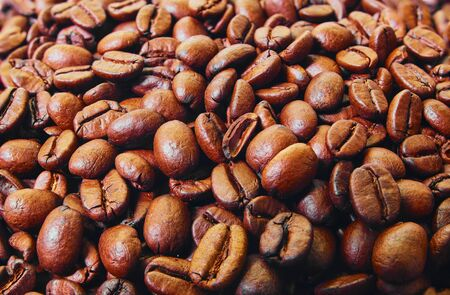 Roasted coffee beans background. Top view. Space for text.