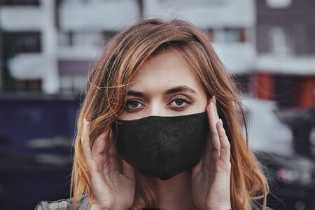 Portrait of concerned teenage girl to wear protective face masks