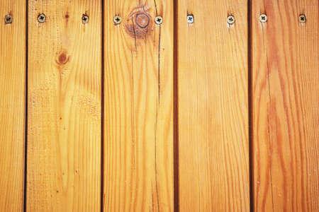 Wooden slats background enshrined with screws