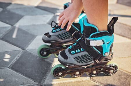 Roller skates and shoes. Childhood, activity.Selective focus