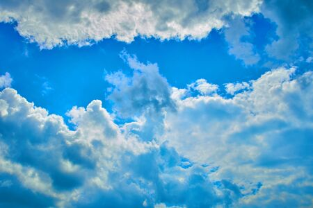Beautiful blue sky with white clouds in a bright summer day