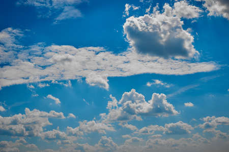 Beautiful blue sky with white clouds on a bright Sunny summer day. 版權商用圖片