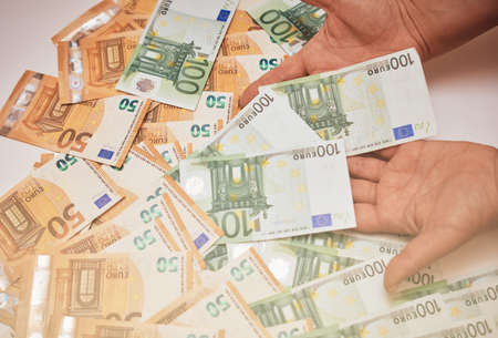 Euro banknotes in female hand. Euro cash background of money