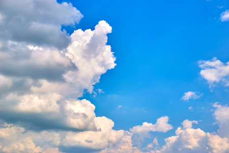 Blue sky with white clouds on a summer day, background