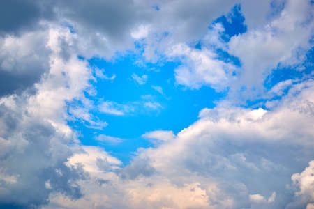 Blue sky with white clouds on a summer day