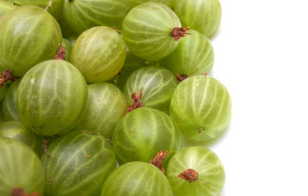 Heap of green gooseberries isolated on white background.