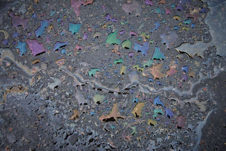 Oil stain on asphalt as texture or background.Environmental pollution concept. Stock Photo