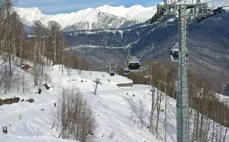 to go up: Tourists go up in the gondola ski lift resort Rosa Khutor to go skiing and snowboarding