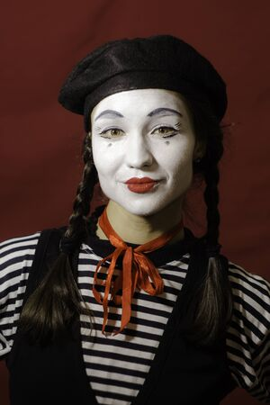 Beautiful mime girl smiling, looking at the camera.