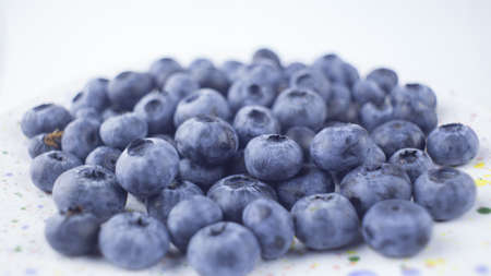Close-up of ripe juicy blueberries on a white background. Banco de Imagens