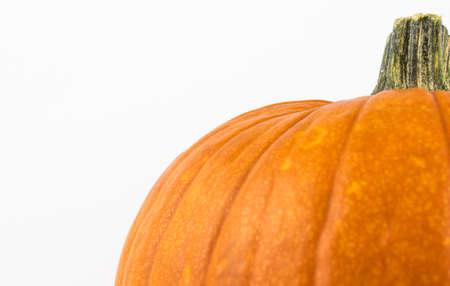 Ripe orange pumpkin on a white background. Halloween pumpkin on a white background.Fresh organic pumpkin on a white background. Banco de Imagens