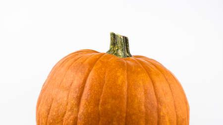 Ripe orange pumpkin on a white background. Fresh organic pumpkin on a white background. Halloween pumpkin on a white background.