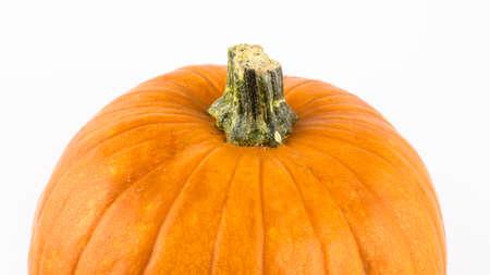 Halloween pumpkin on a white background. Ripe orange pumpkin on a white background. Fresh organic pumpkin on a white background.