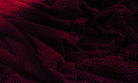 Dark burgundy waves from terry cloth.colorful fabric texture background. 写真素材