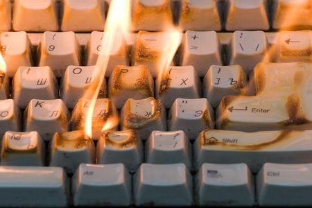 blazes: Fire on a desktop. The poor-quality computer blazes.