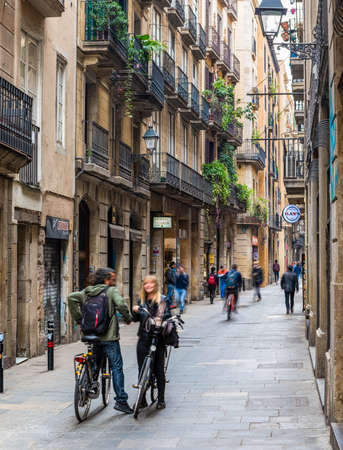 couple talking in a typical Barcelona street