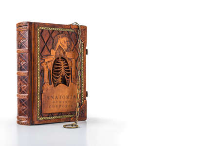 Isolated old anatomy book with chain Stock Photo - 81902037