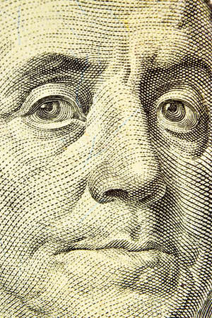 Dollar bill close up, detail with a face