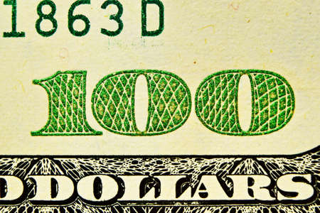 One hundred dollars bill close up, detail with green number