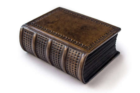 Small, dark brown leather book with black paper edges captured isolated laying to the table