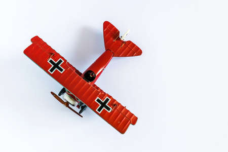 Red Baron airplane toy captured from the top on white background