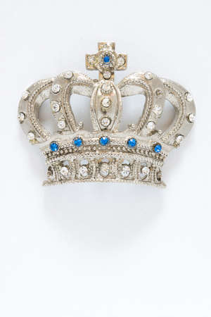 Isolated silver crown with blue and white gems