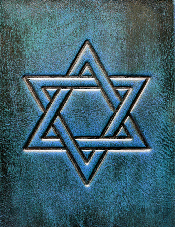 The Star of David, embossed to the aged blue leather