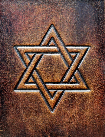 The Star of David, embossed to the aged brown leather Archivio Fotografico