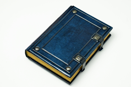 Blue leather book with aged pages and metal clasps. Archivio Fotografico