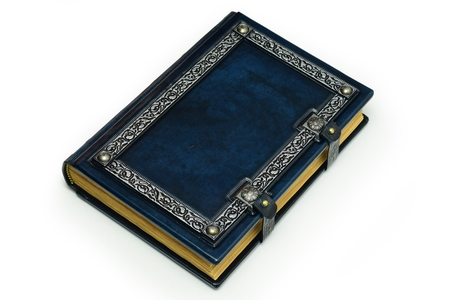Blue leather book with silvered frame, aged pages and metal clasps.