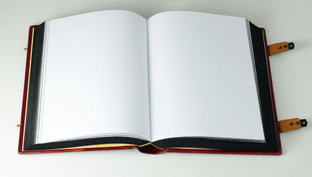 Opened book with white page, clasps and painted paper edges in black color. Light source from the left side
