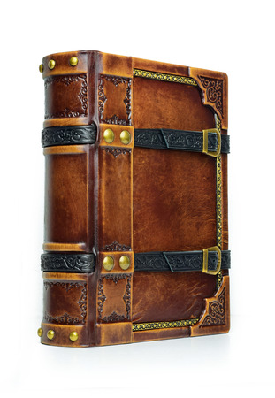 Aged leather book with straps and gilded paper edges - view from the left side