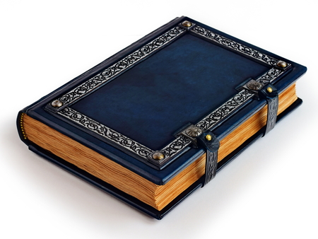 Blue leather bound book with silver frame and aged pages