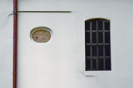Strange lines on old facade and protected window Archivio Fotografico