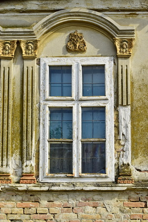 Aged window with nice facade decoration on the old German house Archivio Fotografico