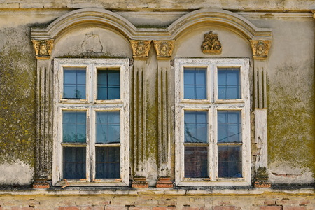 Aged twin window on the old German house