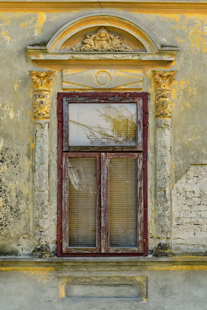 Aged decorated window on the old German house