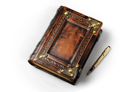 Large leather journal with the gold fountain pen in the book shadow
