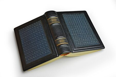Small leather book with patterned surface lay down to the table isolated