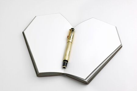 the table isolated and with the gold pen between pages