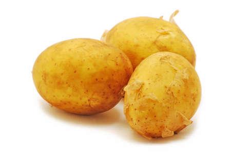 Three potatoes isolated on white background photo