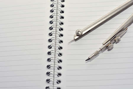 trammel: Opened notebook with trammel Stock Photo