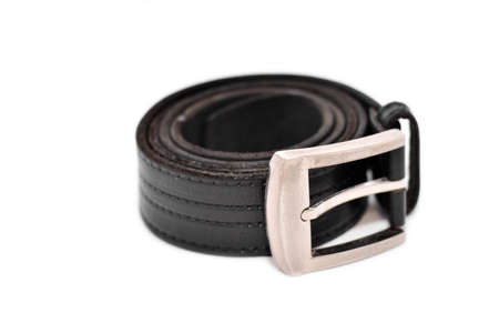 buckle: Black leather belt with metal buckle isolated on white