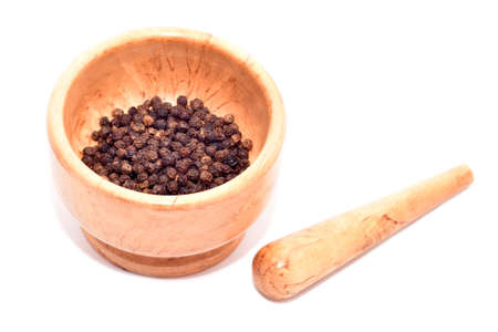 Mortar and pestle with black pepper seeds isolated on white