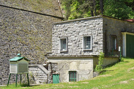 Building made of stones near water barrage Stock fotó