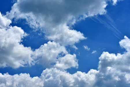 blue sky with rain gathering clouds